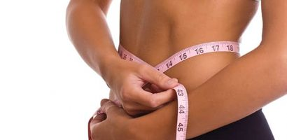 Woman with measuring tape | Get Gritty Nutrition