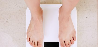 Person standing on scale | Get Gritty Nutrition