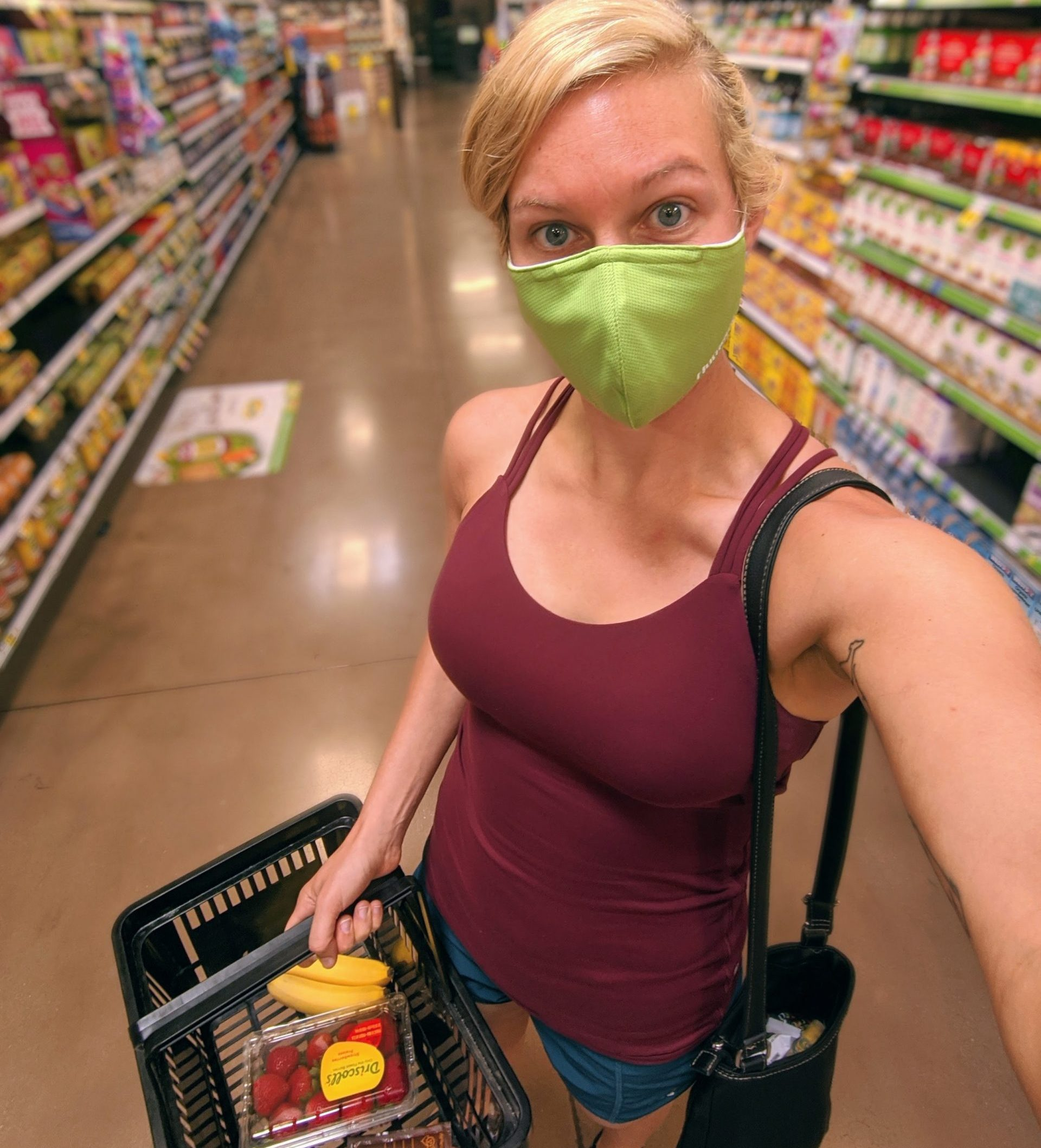 Woman in grocery store with mask | Get Gritty Nutrition